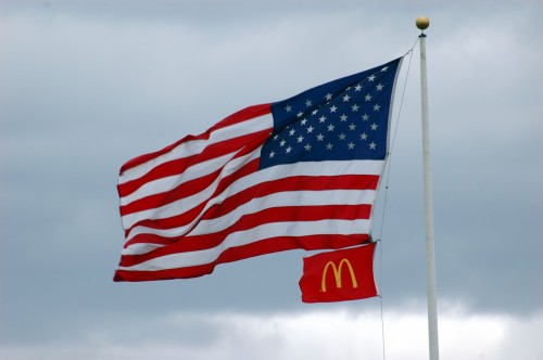 American and Mc Donald's Flags in the wind